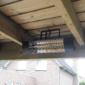 terrasverwarming gemonteerd tussen houten balken plafond